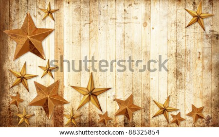 Christmas stars on a weathered country wooden background. - stock photo