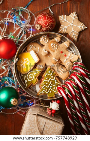 Christmas still life. homemade ginger biscuits, cane candy, on a wooden background.