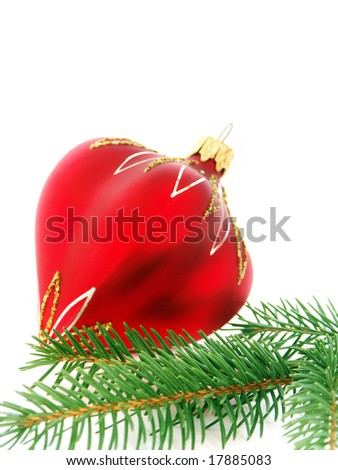 Christmas still life in red tone  - christmas hard and firry twig - stock photo
