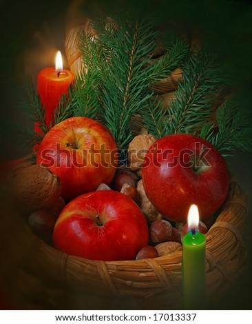 christmas still life with apples,nuts and candles - stock photo
