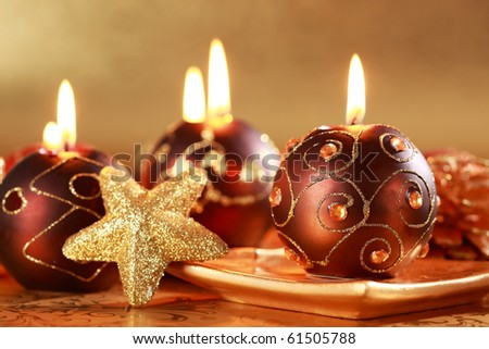 Christmas still life with candles and star in brown and golden tone - stock photo