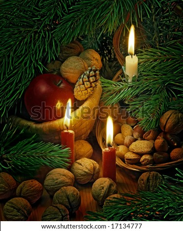 christmas still life with candles,nuts and apples - stock photo