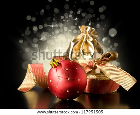 Christmas still life with Christmas decorations, ribbon and gift