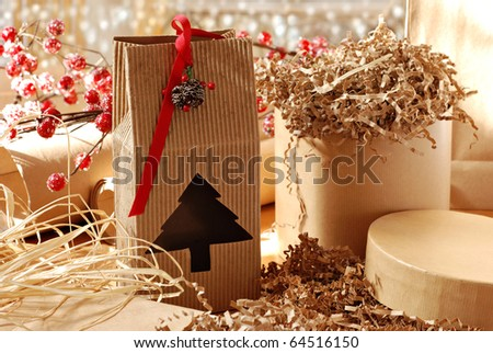 Christmas still life with eco friendly brown wrapping paper and gift packaging.  Close-up with shallow dof. - stock photo
