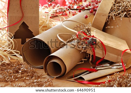 Christmas still life with eco friendly brown wrapping paper and gift packaging. Close-up with shallow dof.