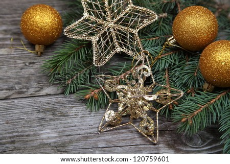 Christmas still life with golden ornaments on a wooden table
