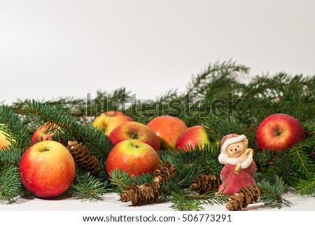 Christmas still life with pine branches, pine cones and apples / Merry Christmas / Happy New Year