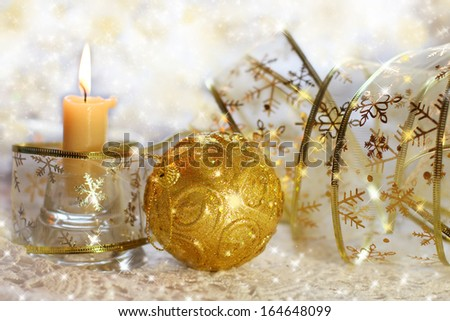 Christmas still life with ribbons, balls and candles
