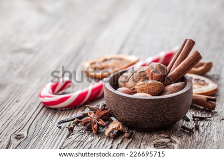 Christmas still life with spices, nuts, traditional Christmas candy and with copy space. - stock photo