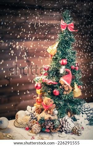 Christmas still life with teddy bears decorating tree  - stock photo