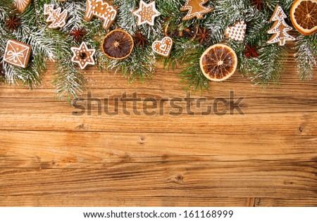Christmas still life with traditional gingerbread cookies on wood - stock photo