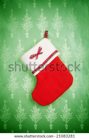 christmas stocking on green background - stock photo