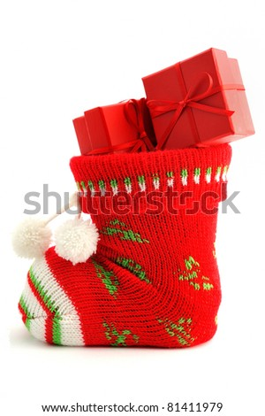 Christmas stocking stuffed with red boxes - stock photo
