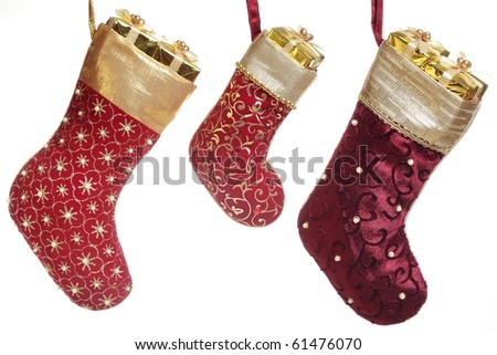 Christmas stocking with gift box hanging over white background. - stock photo
