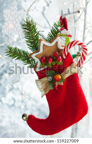 Christmas stocking with gifts,sweets and cookies - stock photo