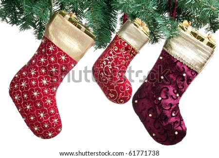 Christmas stocking with green spruce branch hanging over white background. - stock photo