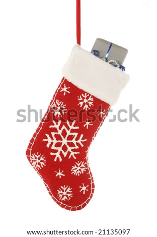 Christmas stocking with present isolated on white - stock photo