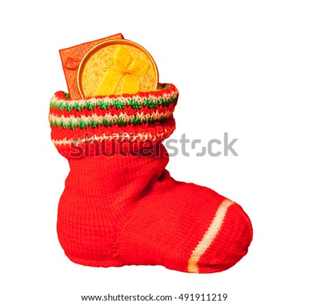 Christmas stocking with presents isolated on white