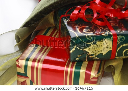 Christmas stocking with wrapped gifts and ribbons