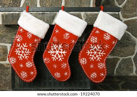 Christmas stockings on a fireplace mantel - stock photo