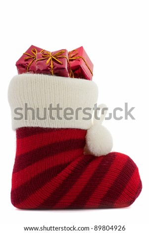 christmas stockings with presents over white background - stock photo