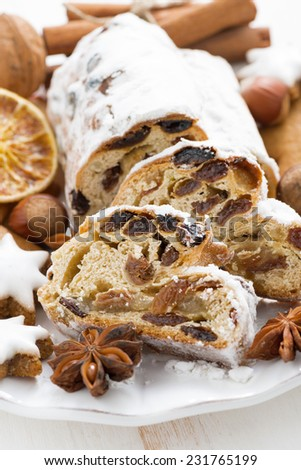Christmas Stollen, assorted cookies and spices, vertical, close-up - stock photo