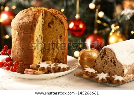 Christmas stollen, cookies and decorations. - stock photo