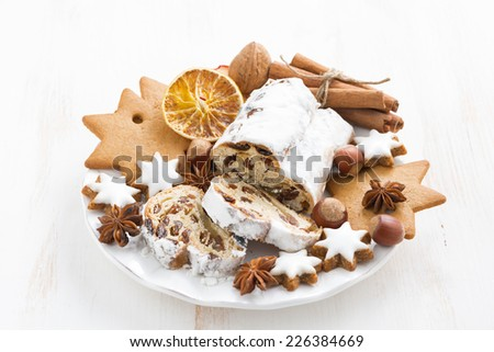 Christmas Stollen, cookies and spices on a plate, horizontal - stock photo