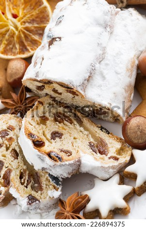 Christmas Stollen, cookies and spices, top view, vertical - stock photo