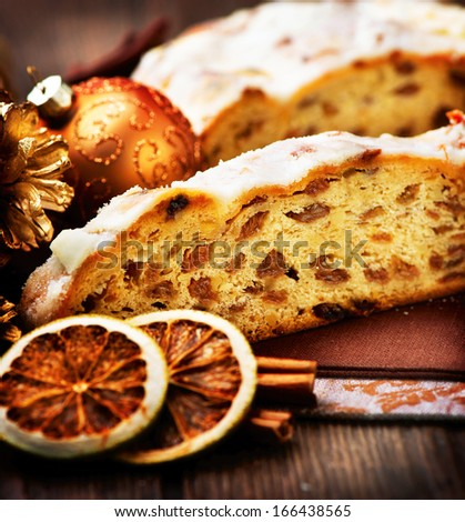 Christmas Stollen. Traditional Sweet Fruit Loaf with Icing Sugar  - stock photo