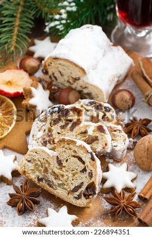 Christmas Stollen with dried fruit, assorted cookies and spices, top view, vertical - stock photo