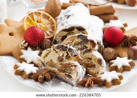 Christmas Stollen with dried fruit, cookies and spices, close-up, horizontal - stock photo