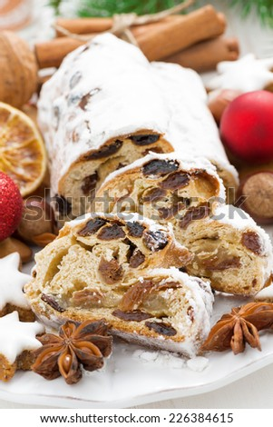 Christmas Stollen with dried fruit, cookies and spices, vertical - stock photo