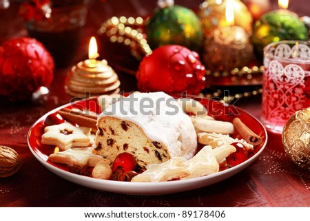 Christmas stollen with gingerbread cookies - stock photo