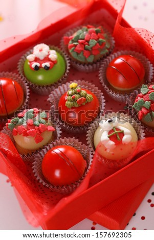 Christmas sweets with marzipan in red box.