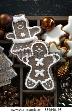 Christmas symbols and cookies in a wooden box, vertical, closeup - stock photo