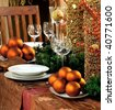 Christmas table decoration. Dishware, decorations and more - stock photo