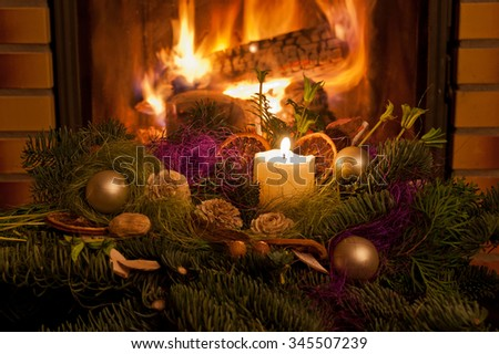 Christmas table decoration in front of fireplace. - stock photo