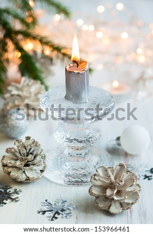 Christmas table decoration with candle - stock photo