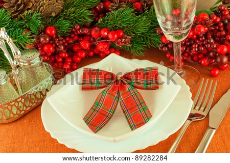 Christmas table layout, multi-colored tape with a branch of berries - stock photo