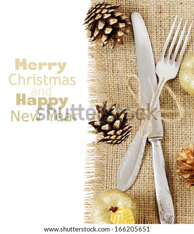 Christmas table place setting with christmas decorations isolated on white background with sample text - stock photo