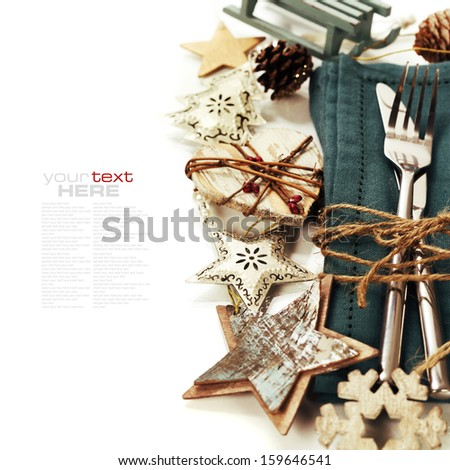Christmas table place setting with christmas decorations (with easy removable sample text) - stock photo