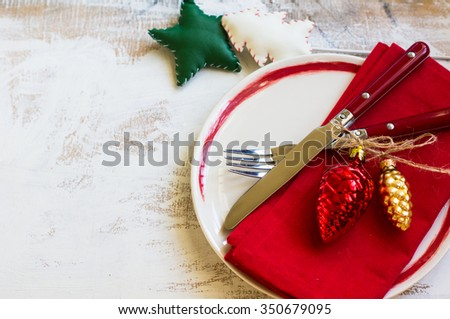 Christmas table setiing with vintage silverware and christmas decoration on rustic wooden table