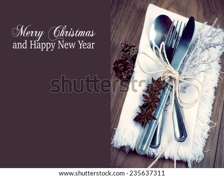 Christmas table setting, christmas menu concept in silver, brown and white color tone on wooden table with copy text space