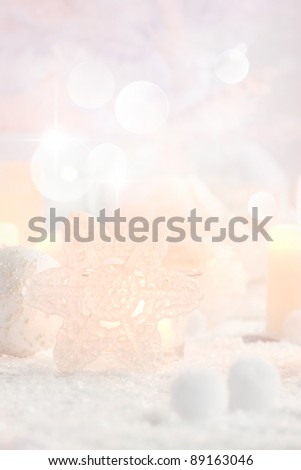 Christmas table setting. Elegant holiday setting with snow and white ornaments - stock photo