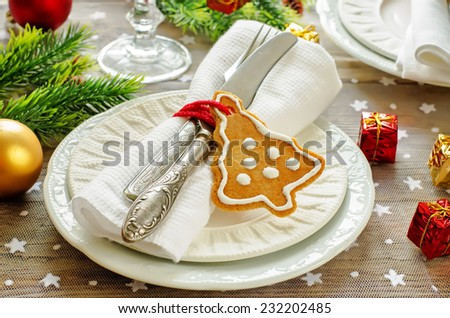 Christmas table setting. Holiday Decorations with cookies. tinting. selective focus - stock photo