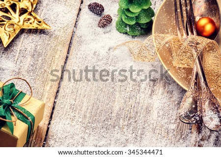 Christmas table setting in gold and green tone. Copy space - stock photo