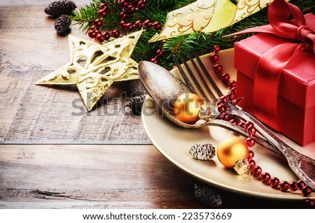 Christmas table setting in gold and red tone - stock photo