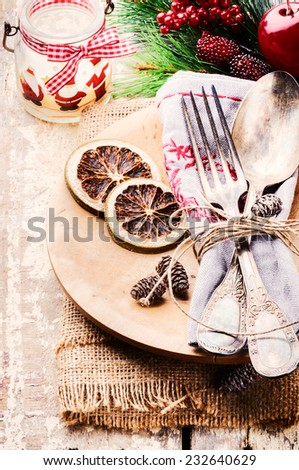 Christmas table setting in rustic style - stock photo
