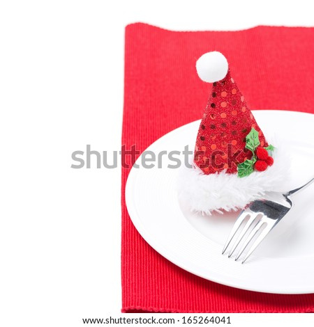 Christmas table setting on a red napkin, isolated - stock photo